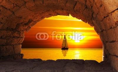 Naklejka Zachód słońca i żaglówka