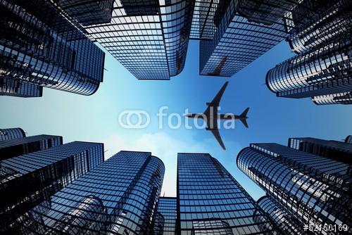 Obraz w ramie Samolot nad wieżowcami
